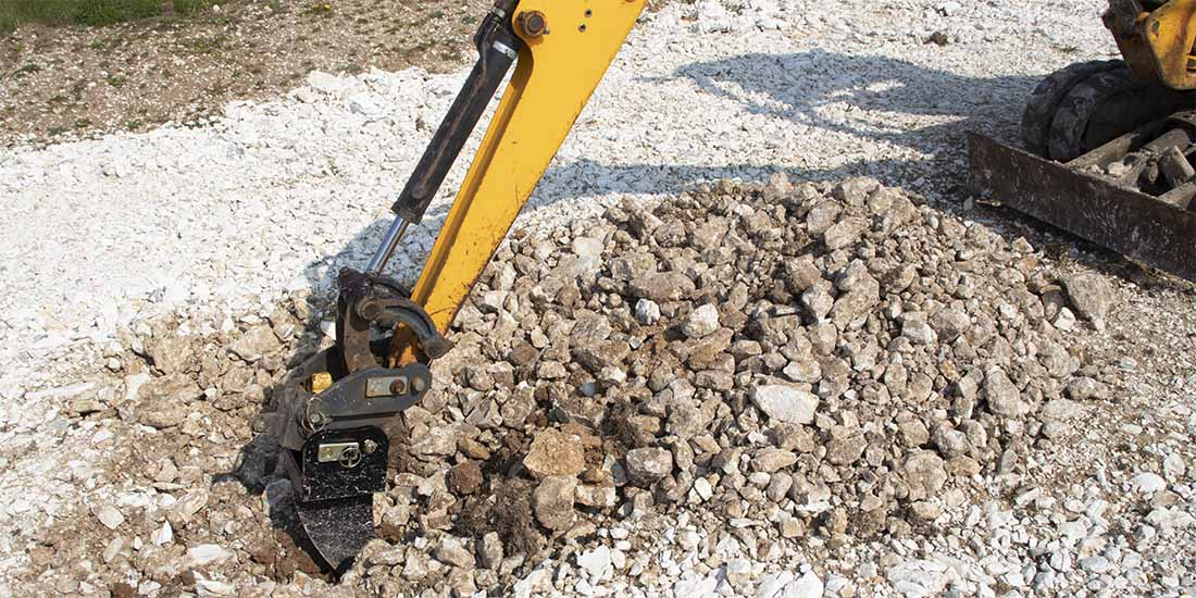 ripper tooth in action on 1.5 ton digger